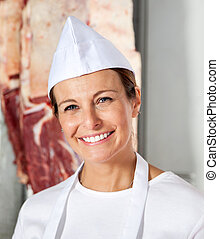 Confident Female Butcher Smiling In Shop