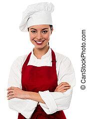 Confident female chef portrait