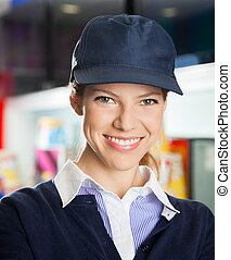Confident Female Concession Worker At Cinema