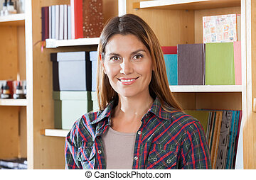 Confident Female Customer Smiling In Book Store