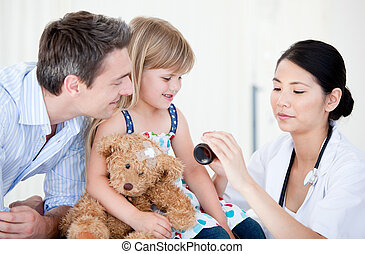 Confident female doctor giving syrup to a little girl