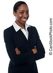 Confident female executive posing