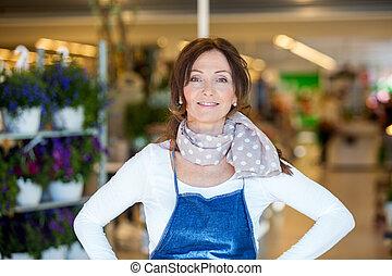 Confident Female Florist In Shop