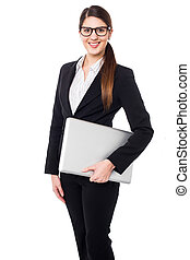Confident female manager holding laptop