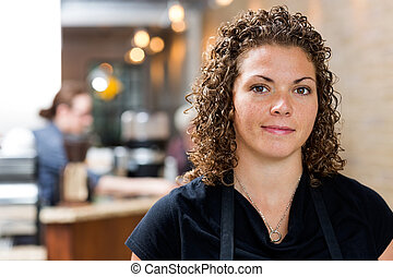 Confident Female Owner At cafe
