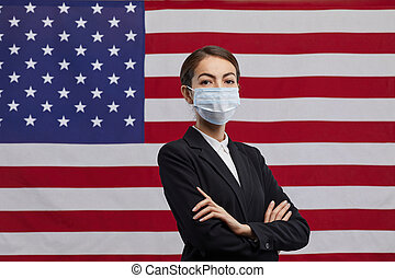 Confident Female Politician Wearing Mask against American Flag