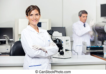 Confident Female Scientist In Laboratory