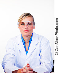 Confident female scientist looking at the camera