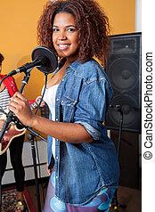 Confident Female Singer In Recording Studio