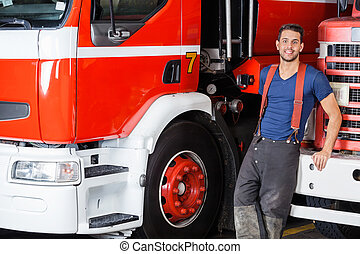 Confident Firefighter Leaning On Truck