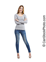 Confident full body of a casual happy woman standing wearing...