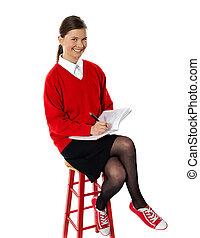Confident girl doing her homework
