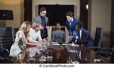 Confident Group Of Young Professionals In A Meeting.