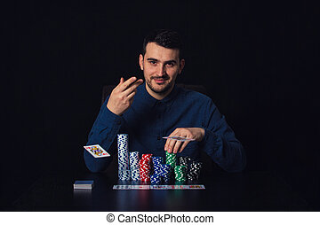 Confident guy poker player seated at the casino table ...