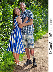 Confident handicapped man with his wife