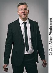 confident handsome senior businessman