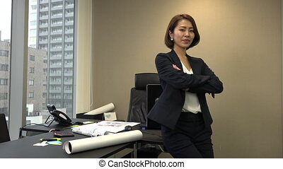 Confident Happy Asian Business Woman Manager Smiling In Office
