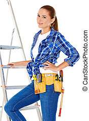 Confident happy DIY handy woman with a tool belt round her...