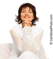Confident happy senior adult woman sitting and smiling with...