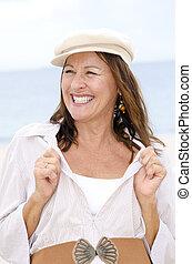 Confident happy senior woman isolated outdoor