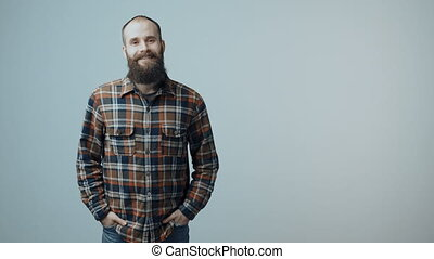 Confident hipster bearded man