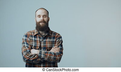 Confident hipster bearded man - Bearded man entering in...