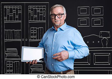 Confident intelligent man holding a tablet