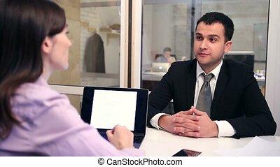 Confident job applicant having interview.