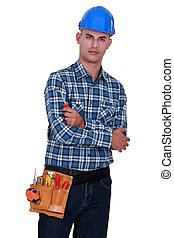 Confident laborer with arms crossed