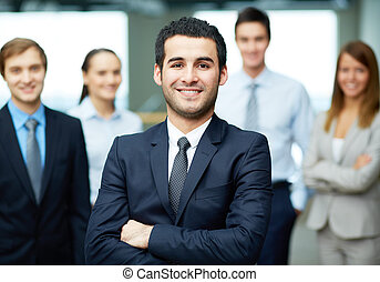 Confident leader - Group of friendly businesspeople with...