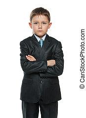 Confident little boy in suit