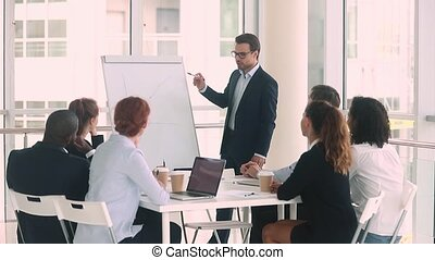 Confident male business coach give flipchart presentation...