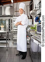 Confident Male Chef In Kitchen