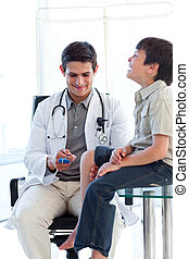 Confident male doctor checking a patient\'s reflex during a...