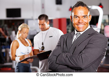 confident male gym manager portrait