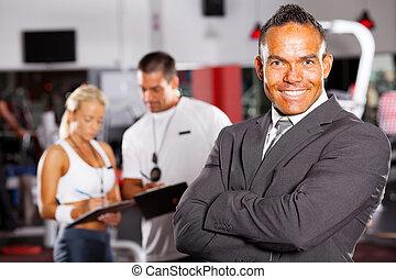 confident male gym manager portrait