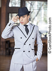 Confident Male Holding Hat While Performing Tango