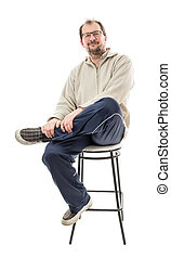 Confident male model with crossed legs. - Confident male...