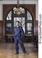 Confident Male Tango Dancer Standing In Restaurant