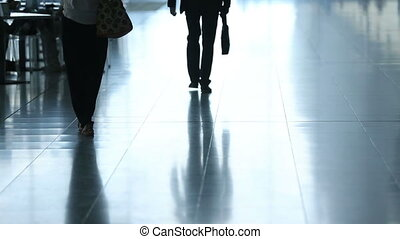 Confident man in black suit walking on the business center