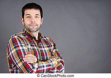Confident man on grey - Confident, trustworthy, friendly ...