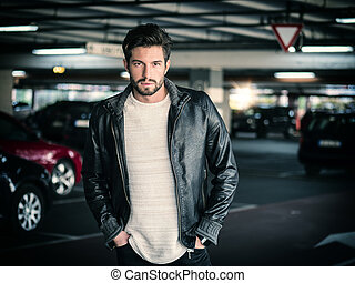 Confident man posing on parking