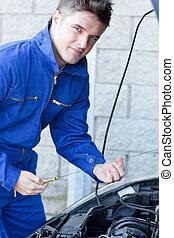 Confident man repairing a car