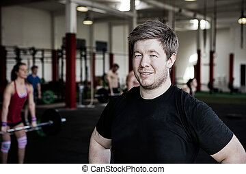 Confident Man Smiling In Fitness Center
