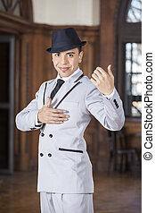 Confident Man Smiling While Performing Tango