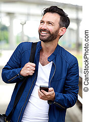 Confident man with cell phone