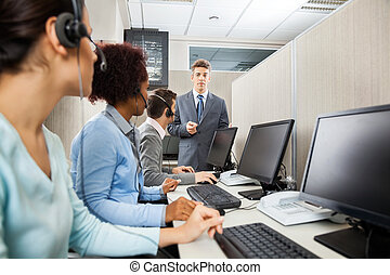 Confident Manager In Discussion With Customer Service Representa
