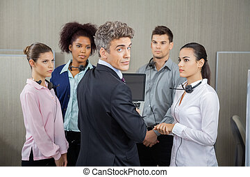 Confident Manager In Meeting With Employees At Call Center -...