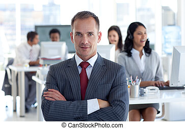 Confident manager leading his team in a call center