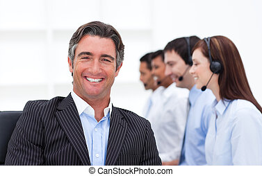 Confident manager presenting a call center